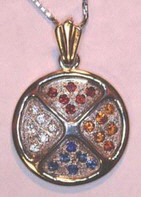 medicine wheel cast Each quadrant has 6-2mm stones. Diamonds, Garnets, Citrine and Sapphires