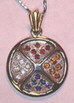 medicine wheel pendant in gold with 2mm garnets, citrines, sapphires and diamonds