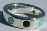 Circle ring 2mm Onyx and Turquoise stones alternating around the band with one central coral stone