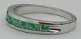 14k white thin band with 7 - 2.5mm channel set emeralds on 4 or 5mm wide band