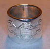 silver ring with engraved bats