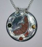 Flying Hawk in silver on silver with Coral, Diamond, Citrine,and Onyx