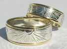 Sunburst, feather and wolfpaw with gold ribs  in gold and silver ring