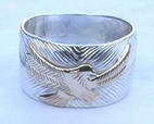 Eagle Landing ring in silver and gold